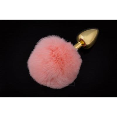 Маленькая золотистая пробка с пушистым розовым хвостиком